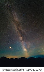 The starry sky on the background of mountains