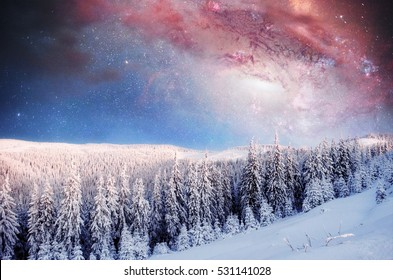 Starry sky in winter snowy night. Fantastic milky way in the New Year's Eve. In anticipation of the holiday. Courtesy of NASA.