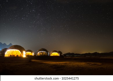 Stars above martian dome tents in Wadi Rum Desert, Jordan.