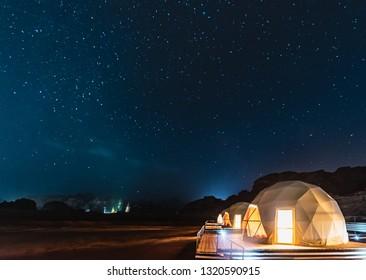 Stars above martian dome tents in Wadi Rum Desert, Jordan. - Shutterstock ID 1320590915