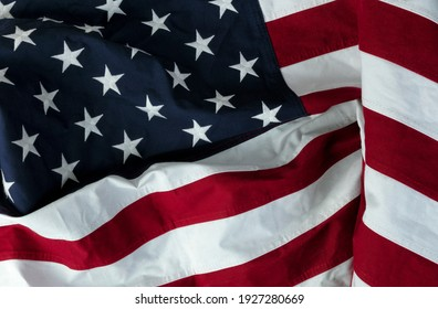 Stars displaying on waving American flag in filled frame layout
