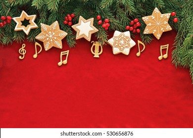Stars gingerbread with music notes , red berries on christmas tree , red velvet