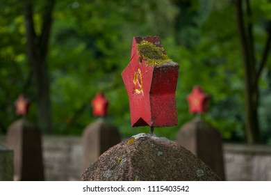 Stars with hammer and sickle at tombstones of cementery of russian soldiers