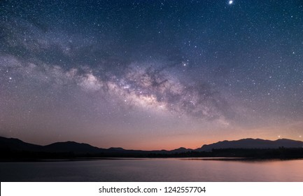 The stars and the Milky Way in the night sky are very beautiful. - Shutterstock ID 1242557704