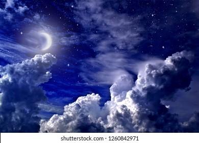Stars,  moon and cumulonimbus in the night sky