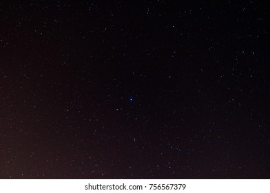 Stars at night with purple and blue shades with stardust visible