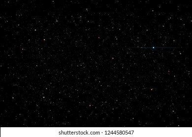 Stars in the night sky background texture milky way glow of stars. The sky is in the stars.