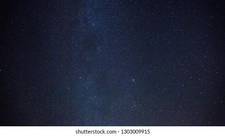 Stars on night dark sky. Beautiful natural sky background.