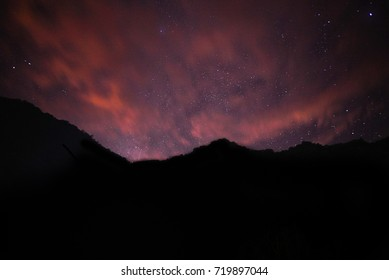 The stars in the sky are mountains in the foreground.