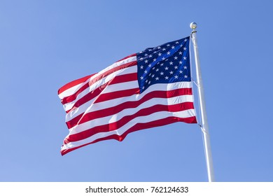 stars and stripes under clear blue sky