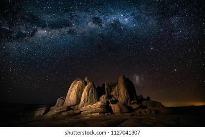 Starscape landscape with natural rocks in the foreground at Kubu Island , Botswana,