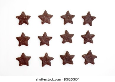 star-shaped chocolate cookies isolated on white background