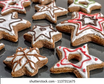 Star-shaped seasonal gingerbread cookies with iwhite cing