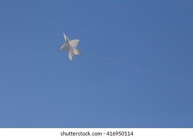 star-shaped thai style kite in blue sky