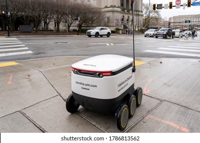 A Starship food delivery robot is driving on the sidewalk in University of Pittsburgh campus in Pittsburgh, PA, USA on January 11, 2020. The Robots are delivering food from four campus restaurants.