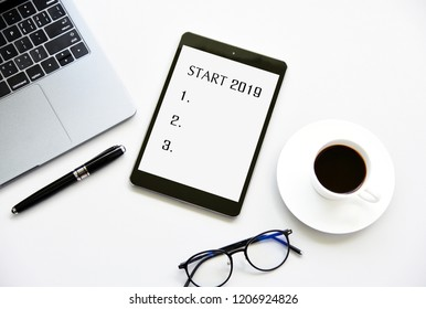 START 2019 Business Concept and Coffee Cup