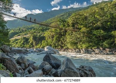At  the start of Annapurna Circuit trek, on trekking trail from Bhulbule village to Ngadi village, along Marshyangdi river, Nepal Himalayas, Nepal