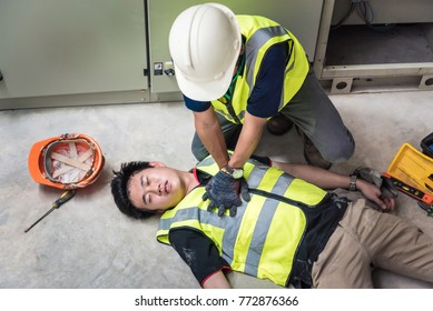 Start Compressions using both hands - 30 times, Life-saving and rescue methods. Accident at work of electrician job or Maintenance worker in the control room of factory.