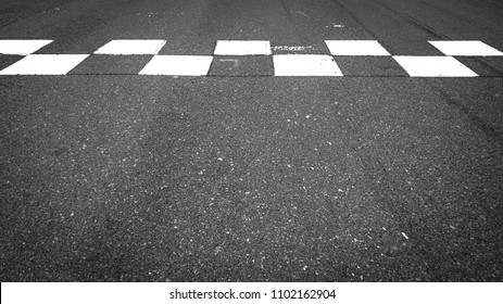 Start and Finish motor race line asphalt in circuit, Checkered line on racing motorsport track.