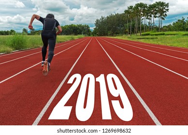 The start into the new year 2019. Start up of runner man running on race track go to Goal of Success, people running as part of Number 2019, copy space.  Holiday sport Concept