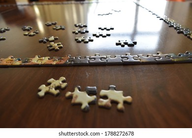Start of a jigsaw puzzle on wooden table