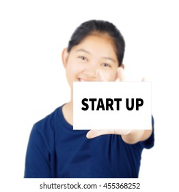 Start Up message on white card concept with young woman smile