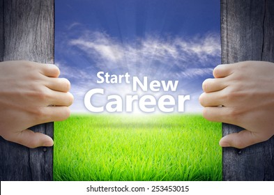 """""""Start New Career"""" Motivational quotes. Hands opening a wooden door then found a texts floating among new world as green grass field, Blue sky and the Sunrise."""