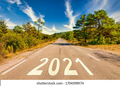 Start of the new year 2021. The number 2021 on a empty Country road in a beautiful landscape. New Year concepts