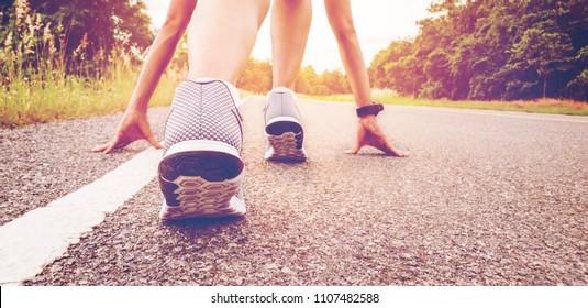 Start of people  running on street,with sunset light.Goal of Success
