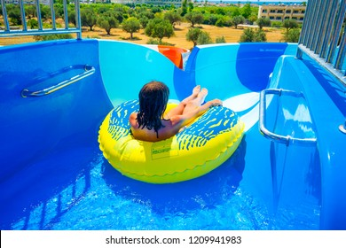 start position on water slide, Miss ready at start in yellow downhill ring