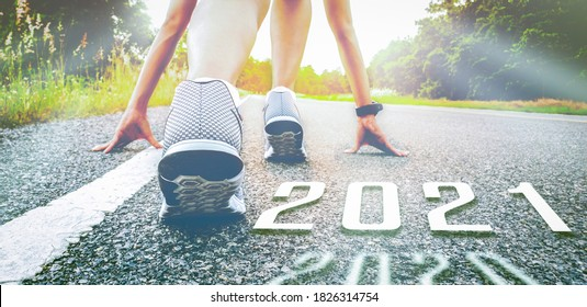 Start runer 2021 symbolizes the start of the new year. The start of people running on the street is healthy new normal with sunset light. The goal of Success.