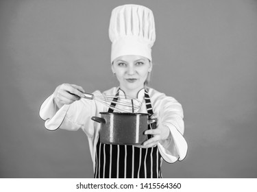 Start slowly whisking whipping or beating cream. Use hand whisk. Whipping cream tips and tricks. Woman professional chef hold whisk and pot. Whipping like pro. Girl in apron whipping eggs or cream.