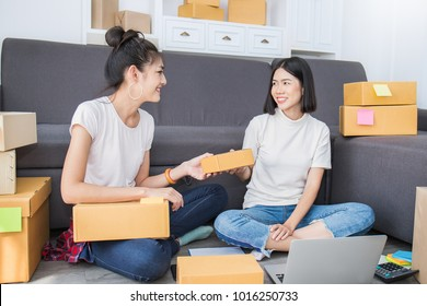 Start up small business entrepreneur SME freelance woman working together with box, Young Asian small business owner home office, online marketing packaging box and delivery, SME e-commerce concept