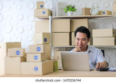 Start up small business entrepreneur SME or freelance asian woman working with delivery box, Young Asian small business owner at home office, online marketing packaging box and delivery, SME concept.