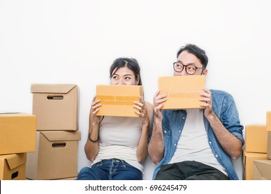 Start up small business entrepreneur SME or freelance woman and man which their hands holding box working at home concept, online marketing packaging box and delivery, SME concept