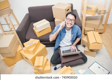 Start up small business entrepreneur SME or freelance man working at home concept, Young Asian small business owner at home office, online marketing packaging and delivery, SME concept top view