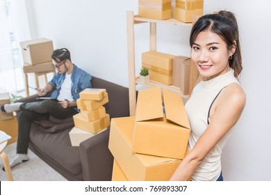Start up small business entrepreneur SME or freelance woman working carry box, Young Asian small business owner at home office, online marketing packaging box and delivery, SME concept