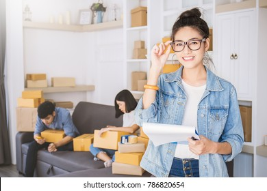 Start up small business entrepreneur SME or freelance woman working with box, Young Asian small business owner at home office, online marketing packing box delivery, SME teamwork moving house concept