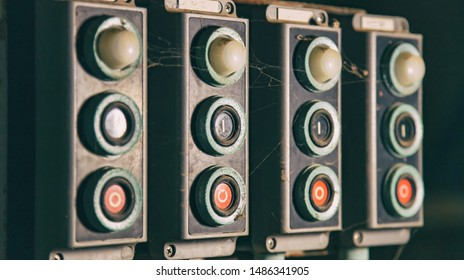 Start, stop concept. Push buttons, switches old retro,  industrial control panel closeup view background