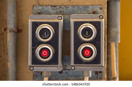 Start, stop concept. Push buttons, red and black color switches old retro industrial control panel closeup view