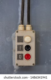 Start, stop concept. Push buttons, red and black color switch, old retro industrial control panel closeup view