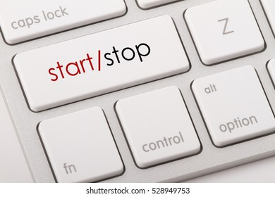 Start and Stop word written on computer keyboard.
