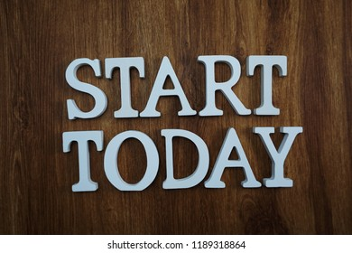 start today alphabet letters top view on wooden background