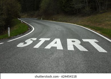 Start word message on the winding curved asphalt country road.