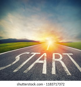 Start written to the ground on a road at sunset. Concept of new beginning and starting new opportunities