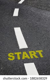 Start written on black asphalt road and white marking lines, Business challenge and road to success idea