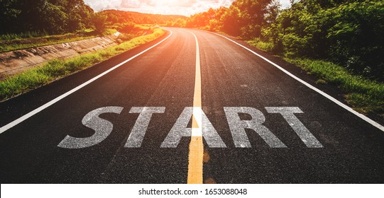 Start written on highway road in the middle of empty asphalt road at  beautiful blue sky.