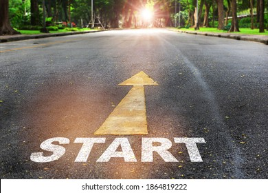 Start written on the road on nature background with sunlight. Business planning concept and beginning success idea