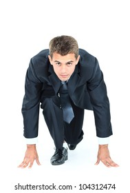 start your business - business man ready to start running over white