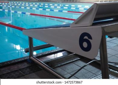Starting Blocks lane 6 at Competitive Swimming Racing Pool with lane ropes